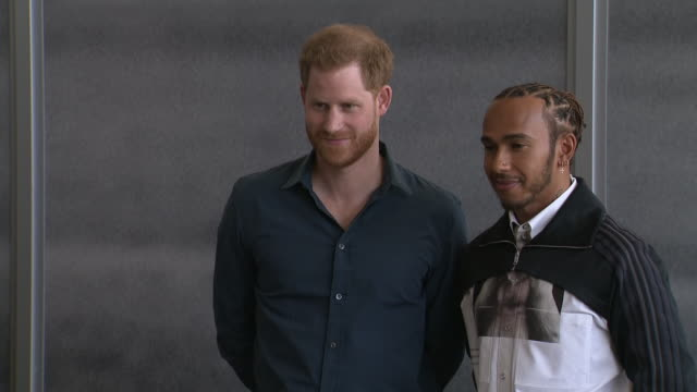 interior shots of prince harry and lewis hamilton posing for photos holding lewis hamilton's first crash helmet on 6 march 2020 in silverstone... - sports helmet stock videos & royalty-free footage