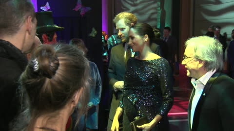 stockvideo's en b-roll-footage met interior shots of prince harry and meghan, duchess of sussex meeting various guests and cast members of cirque de soleil's charity performance of... - royal albert hall
