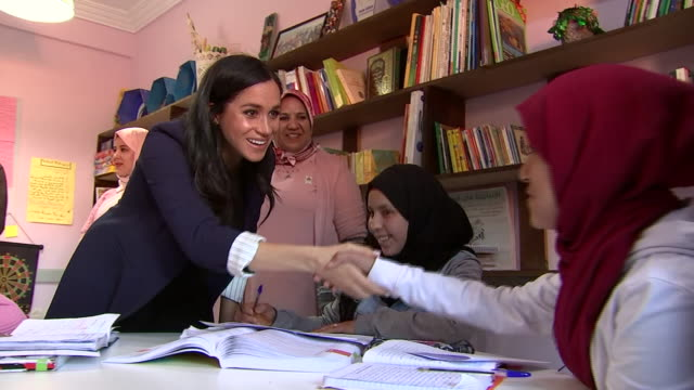 interior shots of prince harry and meghan duchess of sussex meeting schoolgirls in a lesson on a tour of morocco on 24 february 2019 in asni morocco - harry meghan tour stock videos and b-roll footage