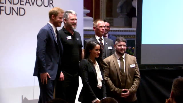 Interior shots of Prince Harry and Meghan Markle congratulating award winners and nominees and posing for photographs before departing from the...