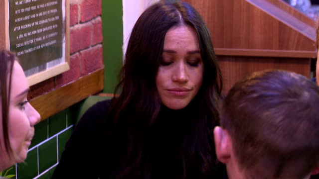 Interior shots of Prince Harry and Meghan Markle meeting members of staff during a visit to Social Bites a social enterprise cafe that distributes...