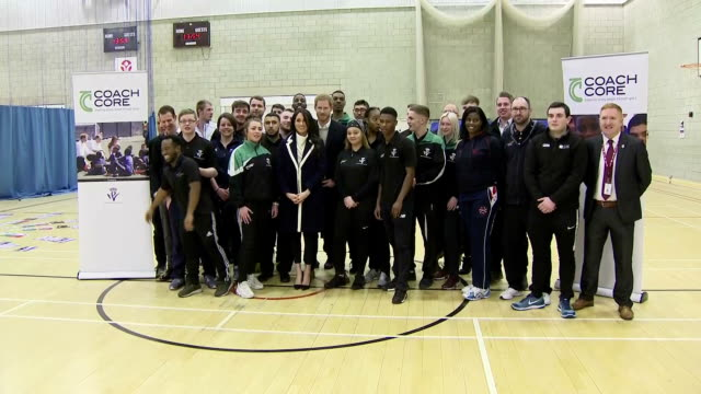 Interior shots of Prince Harry and Meghan Markle posing for a photo opportunity with Coach Core apprentices after watching a training masterclass at...