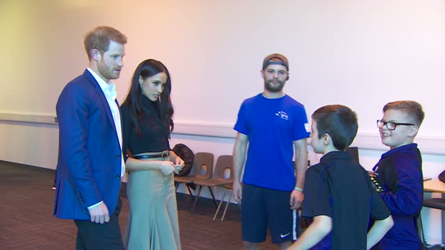 Interior shots of Prince Harry and Meghan Markle speaking to a coach and two boys taking part in a martial arts class during a visit to Nottingham...