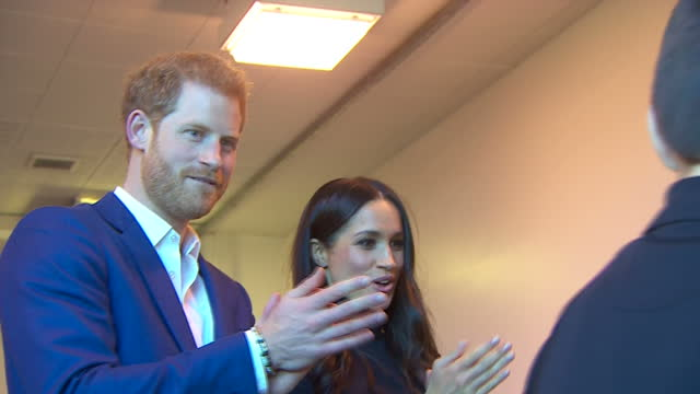 interior shots of prince harry and meghan markle speaking to coaches and children taking part in a martial arts class during a visit to nottingham... - ノッティンガム点の映像素材/bロール