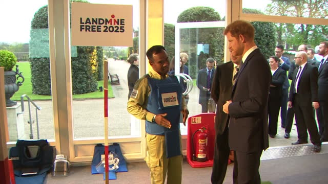 Interior shots of Prince Harry attending a reception to mark International Mine Awareness Day speaking to a representative from a landmine removal...