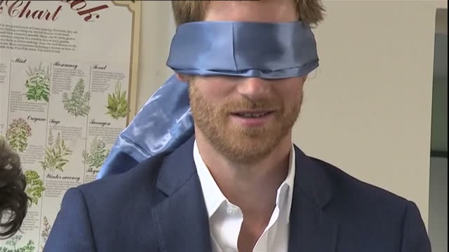 Interior shots of Prince Harry being challenged to ice a cupcake while blindfolded during a visit to Headway House on July 20 2017 in Ipswich England