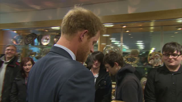 interior shots of prince harry being presented with a case of local craft beers and some smaller gifts for his nephew prince george and niece... - nephew stock videos and b-roll footage