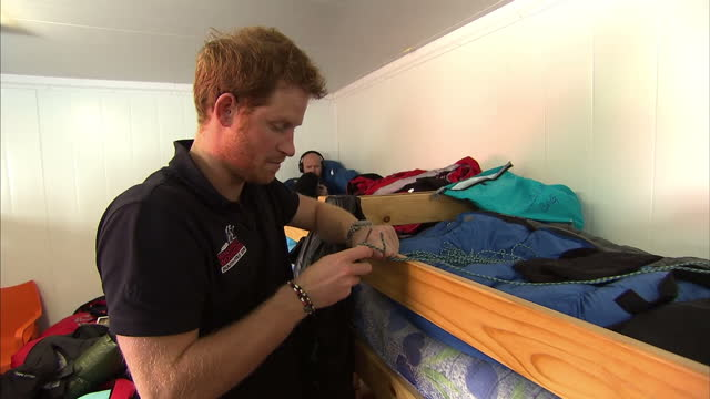 interior shots of prince harry cutting lengths of cord as spare bootlaces and explaining that his previous pair of velcro fastened boots turned out... - too small stock videos & royalty-free footage