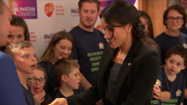 Interior shots of Prince Harry Duke of Sussex and Maghan Duchess of Sussex shaking hands with children attending the WellChild Awards at the Royal...