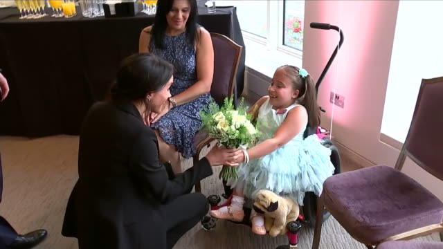 Interior shots of Prince Harry Duke of Sussex and Maghan Duchess of Sussex meeting with sevenyearold Matilda Booth and her mother with Matilda giving...