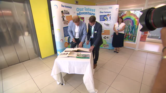 interior shots of prince harry, duke of sussex signing guest book at sheffield children's hospital on 25th july 2019 in sheffield, england. - signierstunde stock-videos und b-roll-filmmaterial
