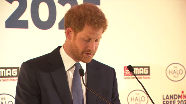 Interior shots of Prince Harry ending his speech by introducing two men who met Princess Diana as children during her campaigning against landmines...