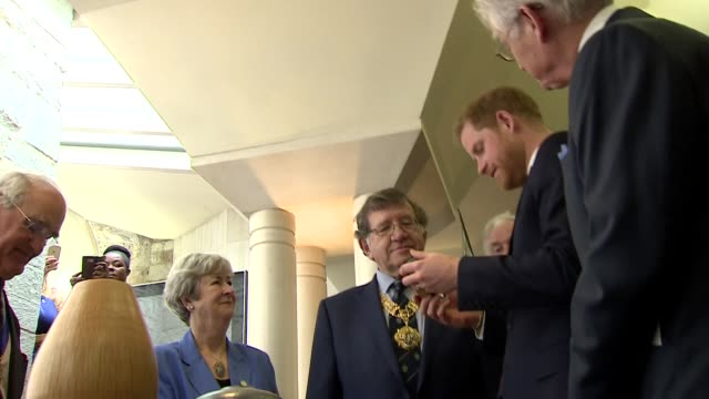 interior shots of prince harry inspecting various arts and crafts works on display during the lord mayor's annual big curry lunch in aid of forces'... - 赤ちゃんの靴点の映像素材/bロール