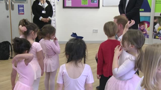 interior shots of prince harry meeting a group of young ballerinas then performing a ballet pose himself whilst on a 'heads together' visit to a ymca... - ballett stock-videos und b-roll-filmmaterial