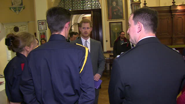 Interior shots of Prince Harry meeting London Fire Brigade personnel and signing a visitors book after attending the London Fire Brigade Carol...