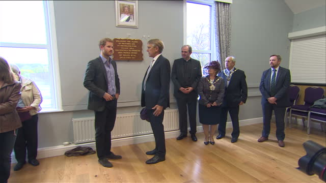 Interior shots of Prince Harry meeting people and unveiling a plaque at the reopening of the village hall on 23 October 2017 in St Michael's on Wyre...