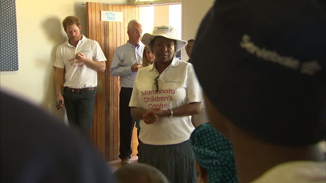 interior shots of prince harry meeting young people during a visit to the sentebale children's home that he supports on november 26 2015 in maseru... - waisenhaus stock-videos und b-roll-filmmaterial