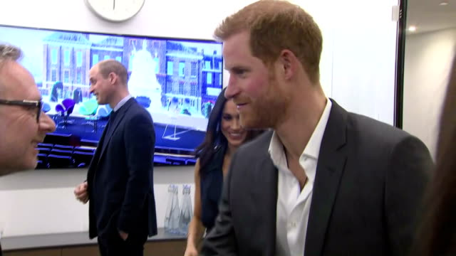 Interior shots of Prince Harry Meghan Markle Prince William and Catherine Duchess of Cambridge looking visibly pregnant meeting staff on a visit to...