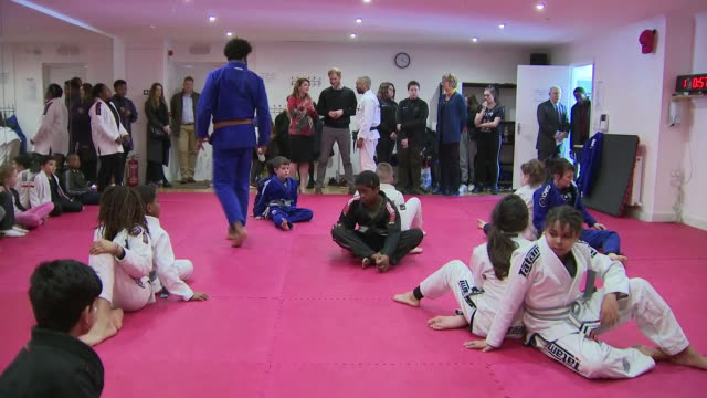 interior shots of prince harry on a visit to a youth centre watching children doing judo on 19 february 2019 in london, united kingdom - 柔道点の映像素材/bロール