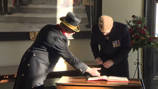 interior shots of prince harry signing the visitors book and speaking to officials after representing the queen at the sovereign's parade for officer... - 表す点の映像素材/bロール