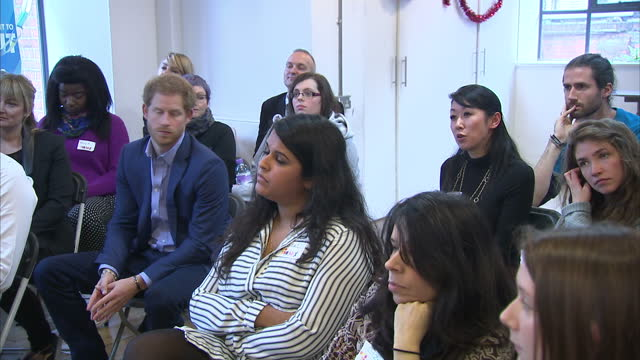 interior shots of prince harry sitting in a group talk on a visit to the heads together christmas party hosted by youth support service the mix on... - annual general meeting stock videos & royalty-free footage