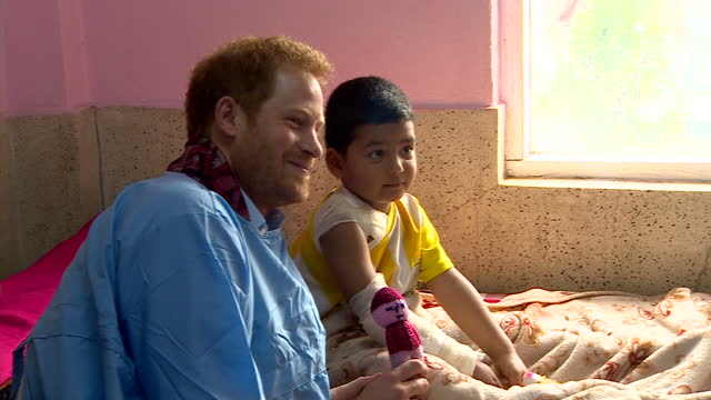 Interior shots of Prince Harry speaking to a young burns patient during a visit to Kanti Children's Hospital>> on March 23 2016 in Pokhara Nepal