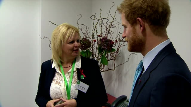vidéos et rushes de interior shots of prince harry speaking to kerry reeveskneip director of fundraising about his mother's work at mildmay hospital on december 14 2015... - 2015