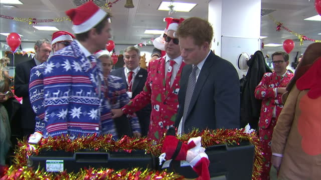 interior shots of prince harry speaking to traders wearing christmas themed suits and santa hats during a charity trading day at icap>> on december... - prinz königliche persönlichkeit stock-videos und b-roll-filmmaterial