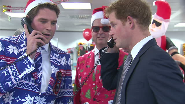interior shots of prince harry taking part in a charity trading day at icap with a group of brokers dressed in christmas themed suits and santa... - prinz königliche persönlichkeit stock-videos und b-roll-filmmaterial