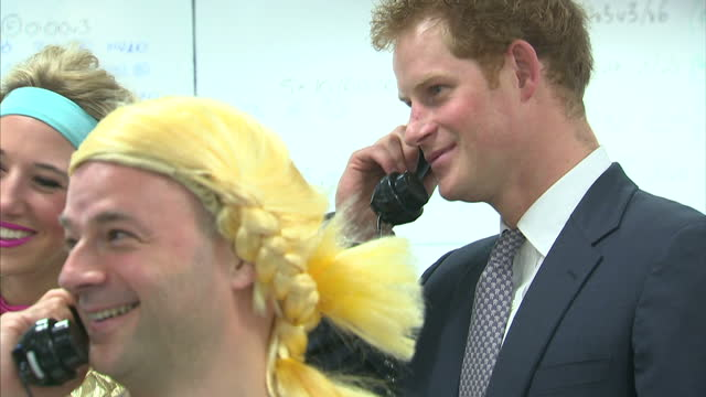 stockvideo's en b-roll-footage met interior shots of prince harry taking part in a charity trading day at icap with a group of traders wearing blonde pigtail wigs and dirndl dresses>>... - pruik