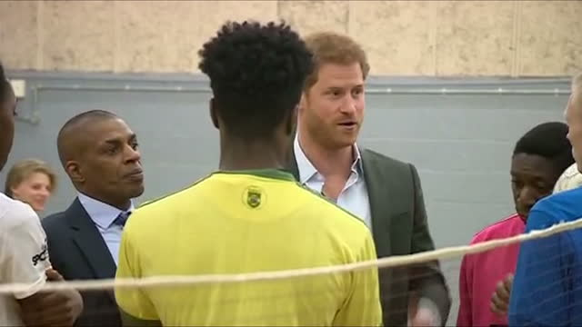 interior shots of prince harry visiting the pink lizard youth and community organisation, speaking to a group of young people at a sports training... - youth organisation stock videos & royalty-free footage