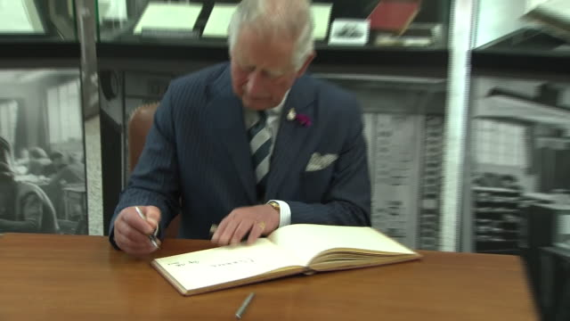 interior shots of prince of wales charles at signs the guest book at gchq on 12th july 2019 in cheltenham england - writing stock videos & royalty-free footage