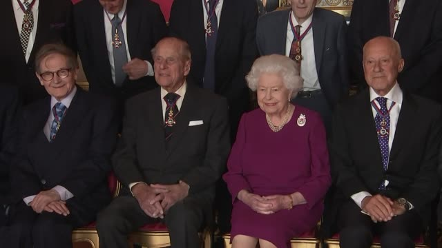 interior shots of prince philip and the queen in a photo op with guests at the order of merit lunch including a shot of prince philip and sir david... - prince philip stock videos & royalty-free footage