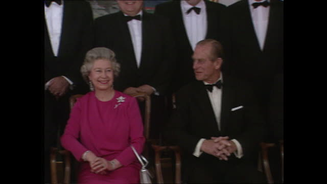 vídeos de stock, filmes e b-roll de interior shots of prince philip duke of edinburgh and queen elizabeth ii posing for family photo with the eu leaders at the 1992 eu summit in... - formato bruto