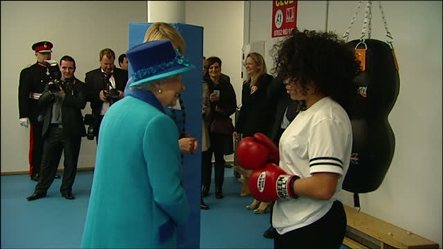 interior shots of prince philip duke of edinburgh and queen elizabeth ii watching demonstrations and speaking to young people and staff at a boxing... - youth club stock videos & royalty-free footage
