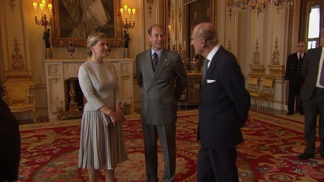 interior shots of prince philip duke of edinburgh chatting with sophie countess of wessex and prince edward at aevent for duke of edinburgh gold... - award stock videos & royalty-free footage
