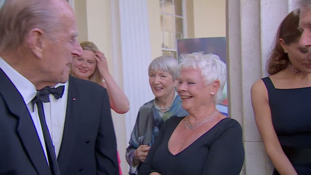 interior shots of prince philip meeting with cast and crew from the james bond film series, including dame judi dench, during a charity gala to... - ジュディ・デンチ点の映像素材/bロール