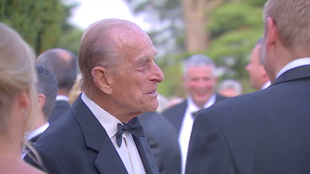 interior shots of prince philip meeting with cast and crew from the james bond film series during a charity gala to celebrate the 60th anniversary of... - james bond film series stock videos and b-roll footage