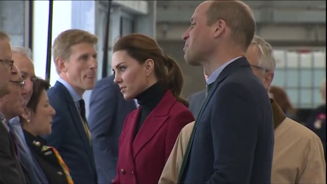 Interior shots of Prince William and Catherine Duchess of Cambridge meeting HM Coastguard crew members and inspecting a Coastguard helicopter on a...