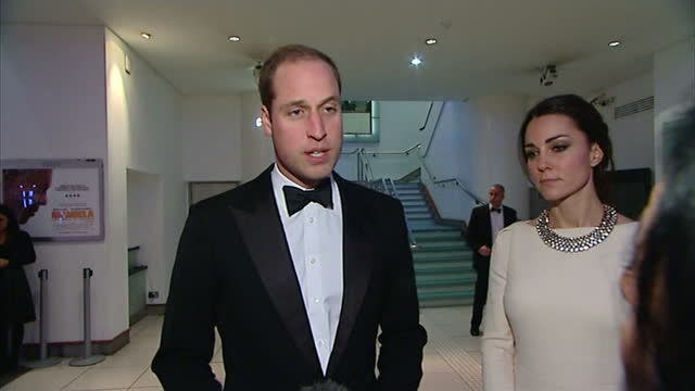 interior shots of prince william and catherine, duchess of cambridge walking down steps after viewing 'mandela: long walk to freedom' and being... - the family man film title stock videos & royalty-free footage