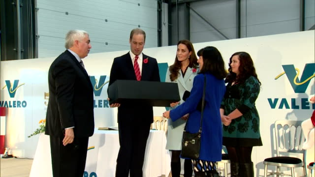 interior shots of prince william and catherine duchess of cambridge being presented with a toy oil tanker truck and flowers and signing a visitors... - pembroke video stock e b–roll