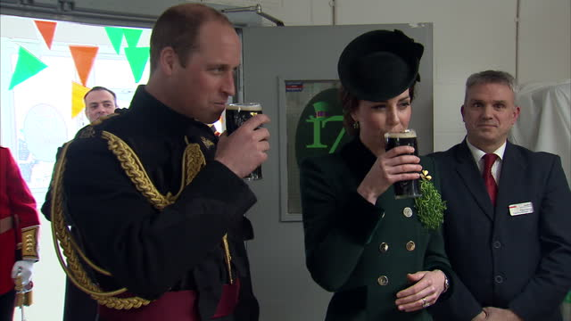 interior shots of prince william and catherine, duchess of cambridge taking part in a st patrick's day ceremony with irish guards, drinking pints of... - st. patrick's day stock videos & royalty-free footage
