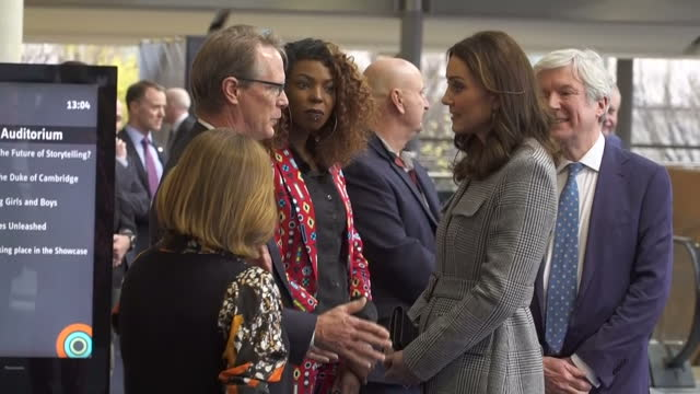 Interior shots of Prince William and Catherine Duchess of Cambridge arriving at the Manchester Central Convention Complex and speaking to Officials...
