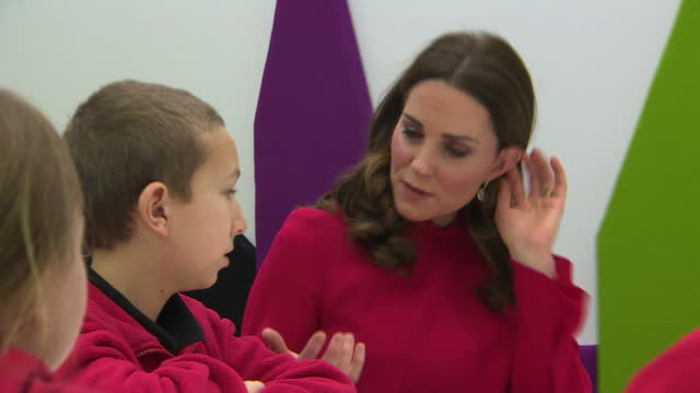 Interior shots of Prince William and Catherine Duchess of Cambridge sat around tables speaking to school children during a Stepping Out Session at...