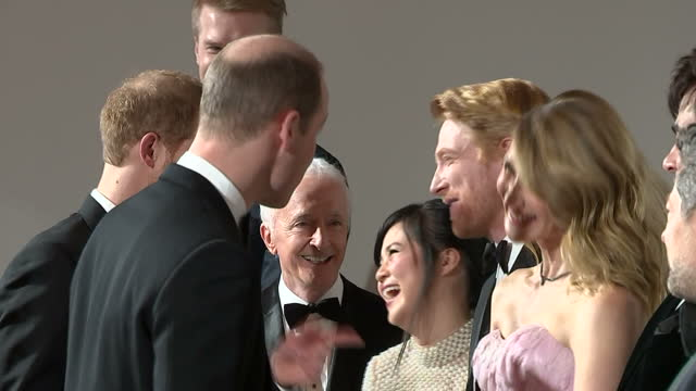 Interior shots of Prince William and Prince Harry meeting various cast members lined up including John Boyega Adam Driver Daisy Ridley Gwendoline...
