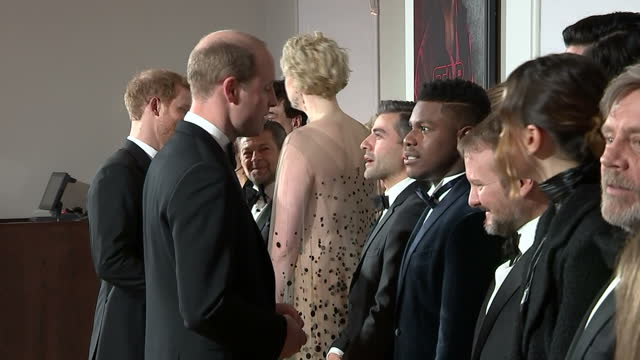 vídeos de stock, filmes e b-roll de interior shots of prince william and prince harry meeting various cast members lined up including john boyega adam driver daisy ridley gwendoline... - estreia