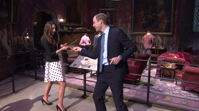 interior shots of prince william & catherine, duke & duchess of cambridge pretend to challenge each other with wands during the inauguration of... - warner bros stock videos & royalty-free footage