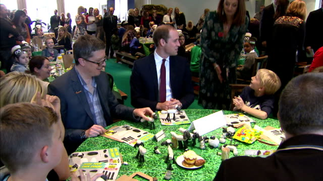 Interior shots of Prince William Duke of Cambridge being competitive with Catherine Duchess of Cambridge whilst taking part in a Shaun The Sheep...