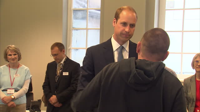 interior shots of prince william duke of cambridge being shown round the passage homeless shelter st vincents centre talking to staff and residents... - homeless shelter stock videos & royalty-free footage