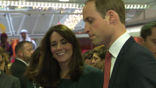 Interior shots of Prince William Duke of Cambridge Catherine Duchess of Cambridge closing deals on the phone on ICAP trading floor with staff in...